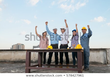 Stock photo: female construction workers high fiving