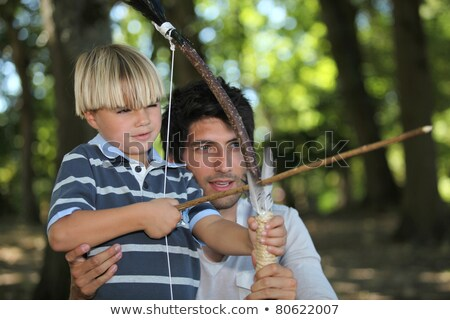 a man and a little boy doing archery in the forest Stock photo © photography33