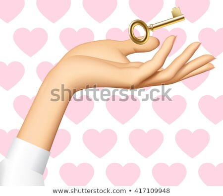 Old golden key picked up from hand to hand isolated on white bac Stock photo © pinkblue