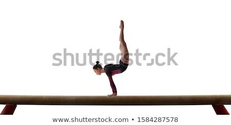 Сток-фото: �расивая · девушка · занимается · гимнастикой · на · белом · фоне