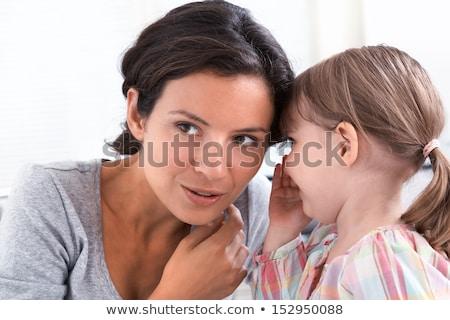 девочку Секреты мамы семьи ребенка Сток-фото © photography33