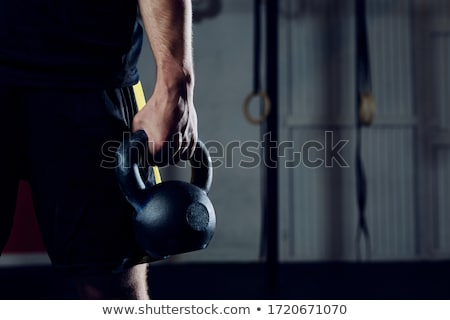 Izmos férfi tart kettlebell fű modell Stock fotó © dash