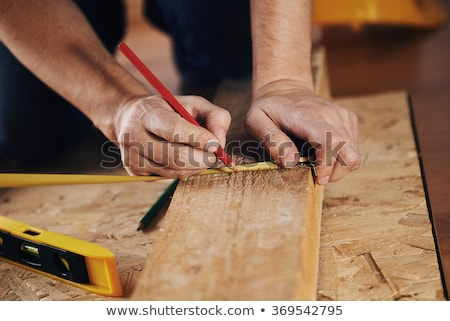craftsman measuring a board stock photo © photography33