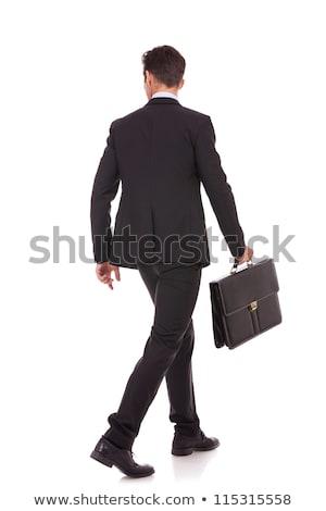 молодые · деловой · человек · чемодан · глядя · сторона · Постоянный - Сток-фото © feedough