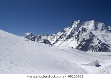 Mountain landscape with snow and man flying in the sky Stock photo © ajlber
