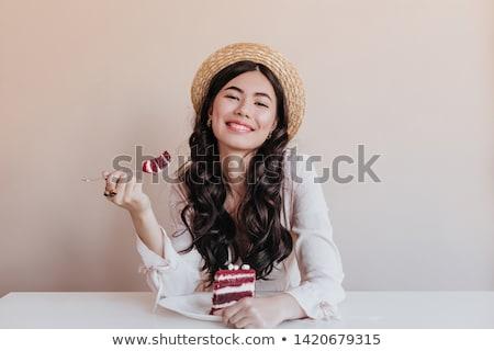 Elegante menina alimentação bolo de chocolate jovem mulher Foto stock © kokimk