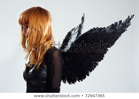 pretty woman and black feather Stock photo © imarin