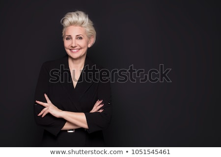 Charming blond lady in black stock photo © acidgrey