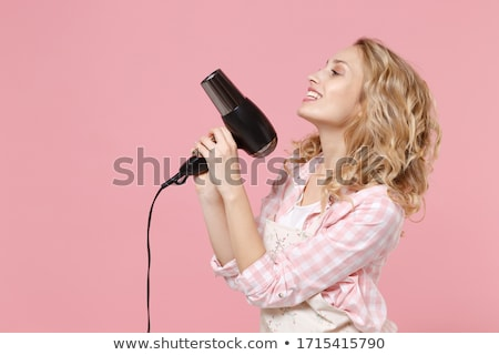 Woman holding hairdryer Stock photo © photography33