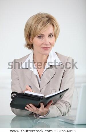 blond · femme · écrit · l'ordre · du · jour · bureau · visage - photo stock © photography33