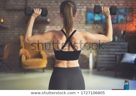 woman with dumbbells Stock photo © ssuaphoto