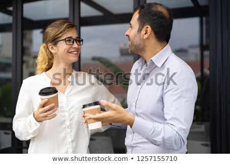Talking businesswoman standing wearing glasses Stock photo © wavebreak_media