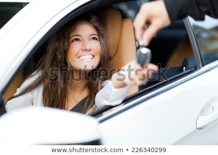 happy woman with car key stock photo © dolgachov