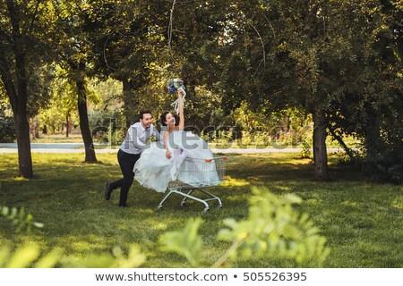 Menyasszony vőlegény lovaglás bevásárlókocsi boldog esküvő Stock fotó © luckyraccoon