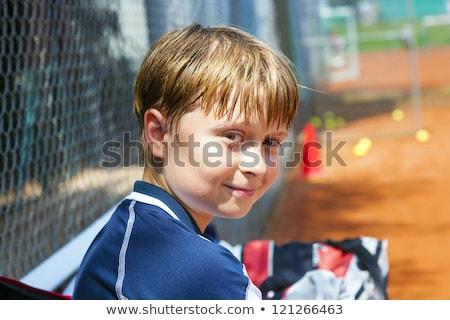 smart smiling boy at the outdoor tennis court stock photo © meinzahn