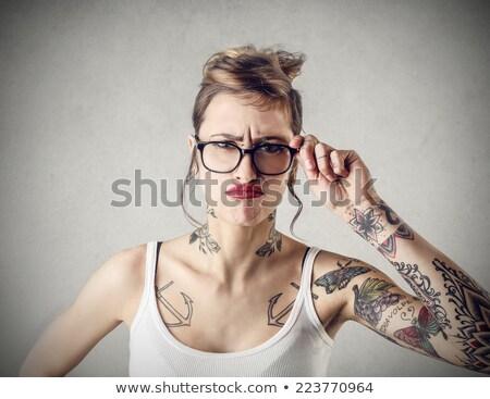 Angry tattooed woman stock photo © iofoto