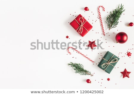 Red christmas decoration on a white tinsel Stock photo © HASLOO