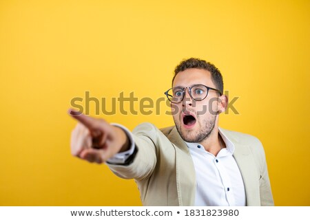 Businessman observing something closely Stock photo © stockyimages