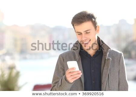 alegre · africano · moço · em · pé · falante · celular - foto stock © stockyimages
