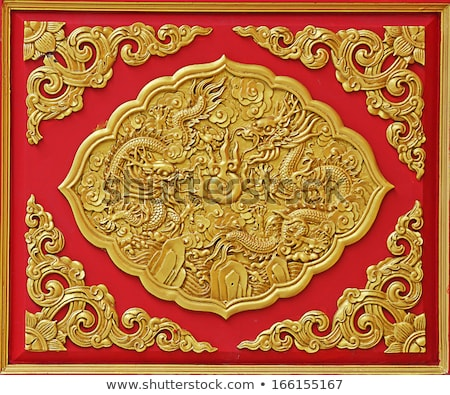 Golden dragon carved from wood Stock photo © smuay