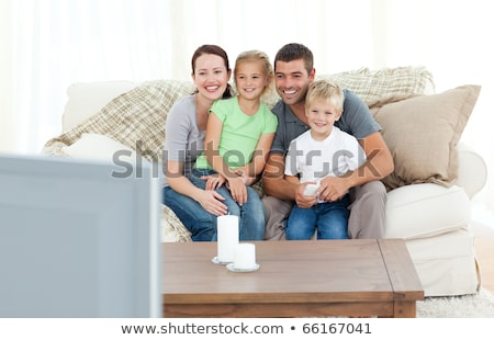 Mother And Children Watching Programme On TV Sitting On Sofa Tog Stock photo © monkey_business
