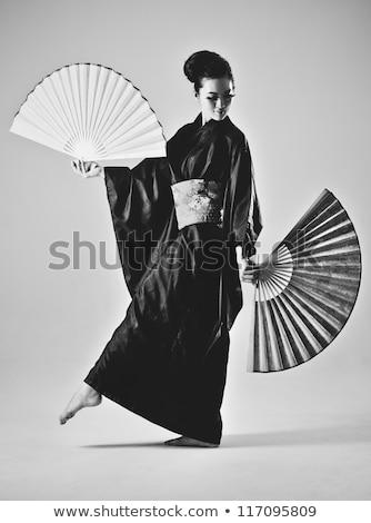 Female fashion model standing in a film studio Stock photo © bmonteny
