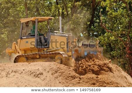 excavator tractors moving dirt stock photo © feverpitch