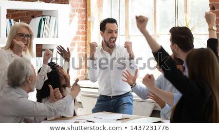 Screaming business professional Stock photo © phakimata