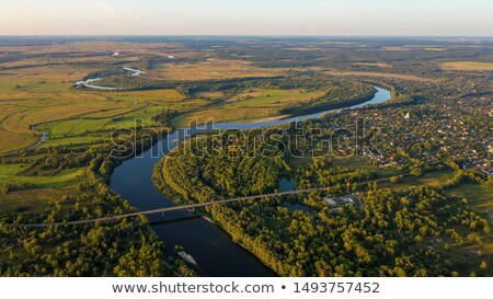 sunset sky over lake or river and home with flood Stock photo © FrameAngel