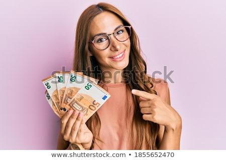 bankjegyek · kéz · pénz · kezek · pénzügy · személy - stock fotó © ambro