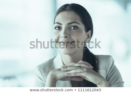 Smiling woman with clasped hands Stock photo © stockyimages