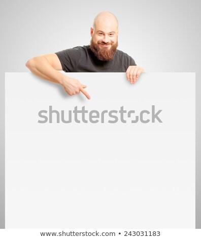 Charismatische man wijzend witte teken modieus Stockfoto © ozgur