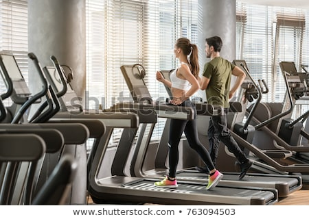 Intensive workout on treadmill, cardio training Stock photo © d13
