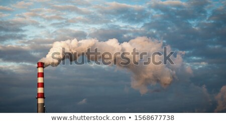 Pipe industrial chimney with smoke against the sky and clouds Stock photo © AlisLuch