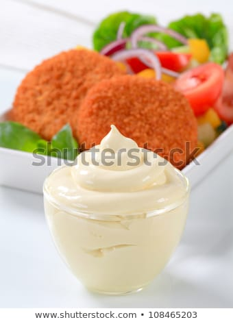 Cup of mayonnaise, fried cheese with vegetable salad  Stock photo © Digifoodstock