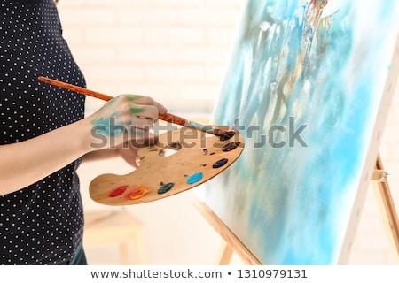 женщину мольберт фотография счастливым краской Сток-фото © OleksandrO