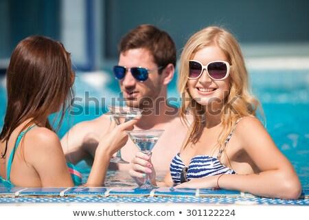 Three vivacious women enjoying cocktails Stock photo © dash