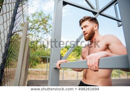 молодые концентрированный бородатый сильный человека спортивных Сток-фото © deandrobot