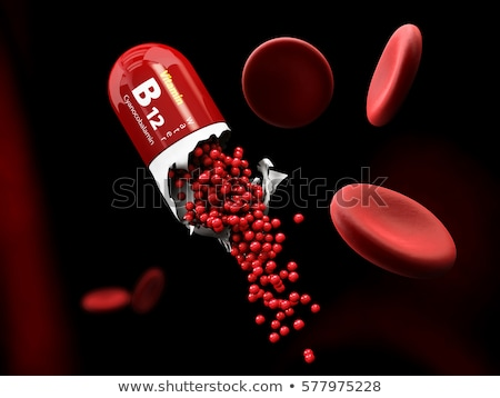 illustration of vitamin b12 capsule dissolves in the stomach stock photo © tussik