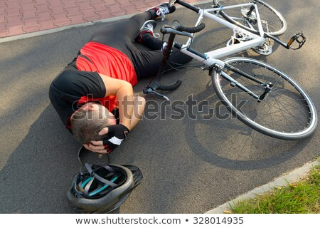Cyclist with bike on his head  Stock photo © wavebreak_media