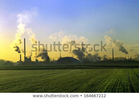 chimneys and smoke of industry plant with fields  Stock photo © meinzahn