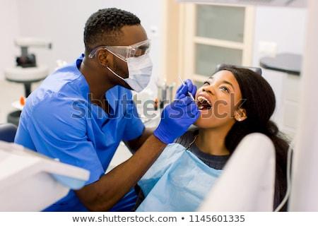 Vrouw tandheelkundige zorg kliniek tandarts werken patiënt Stockfoto © Kurhan