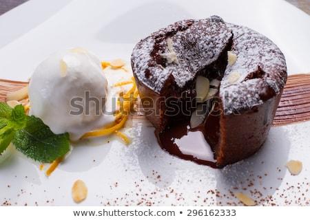 Warm cut chocolate fondant with ice cream and cinnamon. Tasty fr Stock photo © Yatsenko