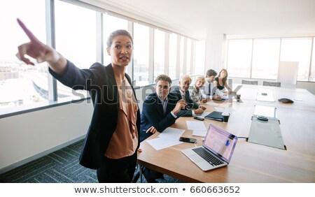 Asian businesswoman showing something important on the tablet vector cartoon illustration. Stock photo © NikoDzhi