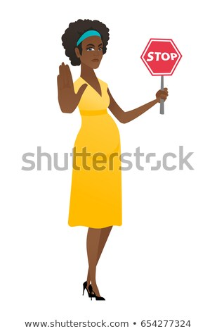african pregnant woman holding stop road sign stock photo © rastudio