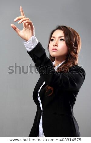деловая женщина прикасаться невидимый интерфейс белый женщину Сток-фото © wavebreak_media