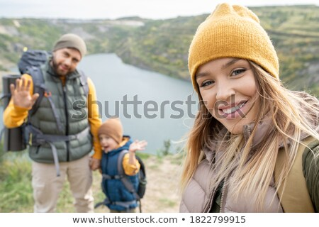 Traveler man with backpack making selfie. Stock photo © RAStudio