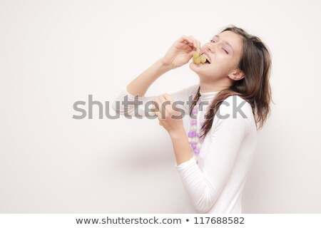 woman looking at grapes stock photo © is2