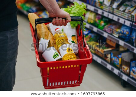 Woman carrying basket of vegetables Stock photo © IS2