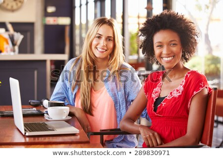 Co-workers in cafe with laptop smiling Stock photo © IS2